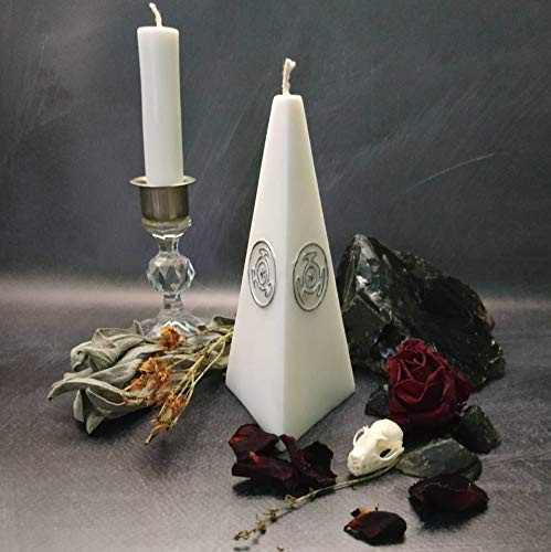 White ritual altar candle with a black and silver symbol of
